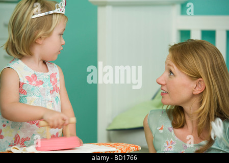 Little girl playing with mother - Stock Photo