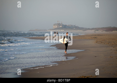 surfer at the baltic beach in De Haan Belgium - Stock Photo