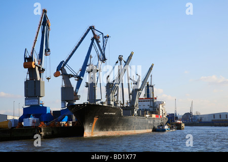 Container cranes and ship  at Port of Hamburg, Germany. - Stock Photo