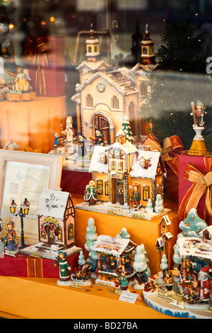 Traditional wooden christmas decorations on display in a shop window in Bavaria, Germany Europe - Stock Photo