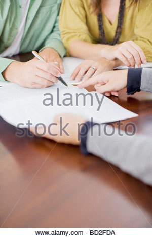 Couple signing contract - Stock Photo