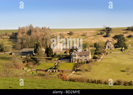 LASBOROUGH VILLAGE WITH THE MANOR HOUSE AND CHURCH IN GLOUCESTERSHIRE UK - Stock Photo