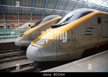 Eurostar trains stand on a platform at St Pancras International Station, London, UK - Stock Photo