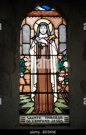 Stained glass window of Sainte Thérèse in the church of Saint-Genest de Lavardin, Loir et Cher, Centre, France (editorial - Stock Photo