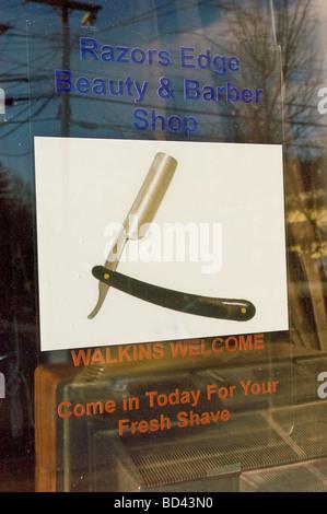 Razor sign on Barber Shop, Trumansburg, , Finger Lakes region, New York, NY, USA, US, United States - Stock Photo