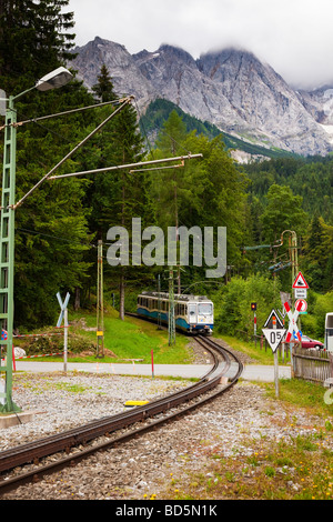 Alps mountain railway and train going up the Zugspitze in Bavaria, Germany, Europe - Stock Photo