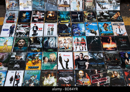 Illegal fake pirate DVD's for sale at Brick Lane. Often sold by predominantly Chinese sellers counterfeit DVD's - Stock Photo