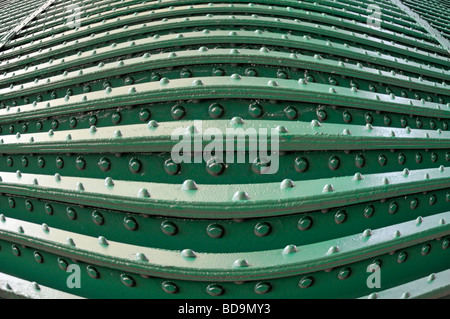 Rivets & rivet heads in steel girder construction on underside of railway bridge closeup as pattern abstract background - Stock Photo