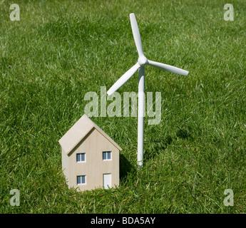 Model house and wind turbine - Stock Photo