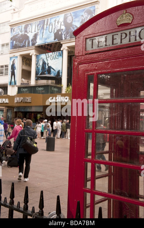 The Empire Cinema and Casino in Leicester Square with Harry Potter film poster advertisments shot past red telephone - Stock Photo