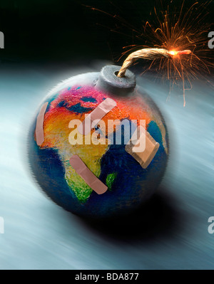 Still shot of a world globe with a lit fuse on it like a bomb - Stock Photo