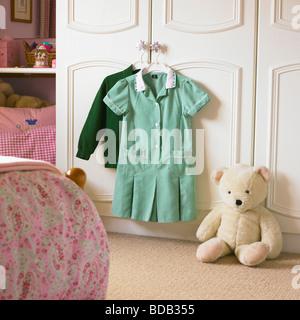 School Uniform ready for wear in a girls bedroom. - Stock Photo