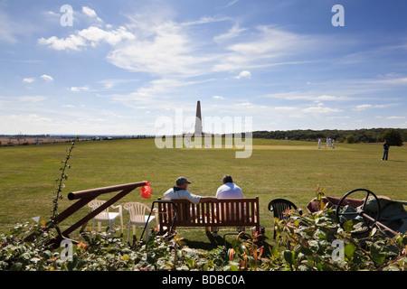 Spectators watch a village cricket match in the shadow of the Bilsington Monument Bilsington Kent - Stock Photo