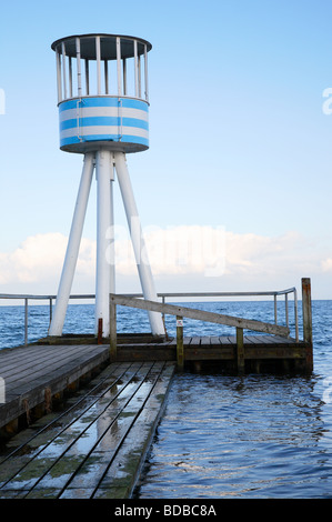 Lifeguard station designed by Arne Jacobsen at the Bellevue Beach resort near Copenhagen in Denmark on a cold day - Stock Photo