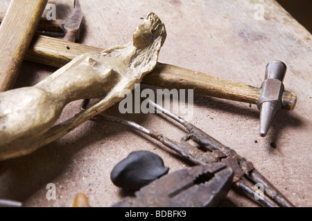 wooden statue and tools in workshop - Stock Photo
