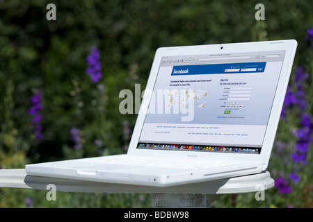 Laptop showing social networking Facebook splash screen page - Stock Photo
