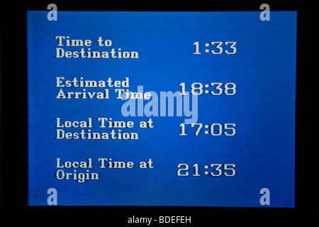 Aeroplane aircraft flight monitor showing arrival time at destination airport and origin airport. - Stock Photo