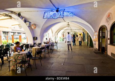 Arcades in the city center, via Roma, Cuneo, Italy - Stock Photo