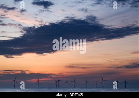 Off shore windfarm at sunrise on Norfolk Coast at Caister on Sea - Stock Photo
