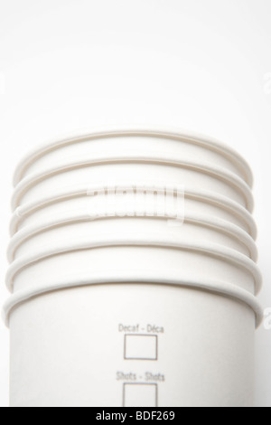 Stack of paper coffee cups. - Stock Photo