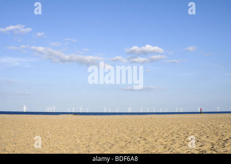 View of North Sea offshore wind farms from the sandy beach of Caister-on-Sea, Norfolk, UK. - Stock Photo