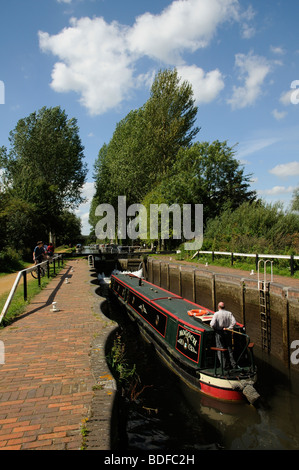 Kennet & Avon Canal narrowboat entering lock at Aldermaston Wharf Berkshire England UK - Stock Photo