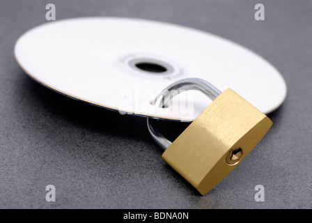 Padlock in a DVD, symbolic image for icon data privacy, security - Stock Photo