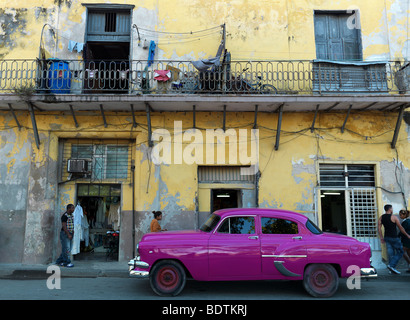 A historic car in the streets of Havanna, Cuba, with its old houses, seen on February 21, 2009 - Stock Photo