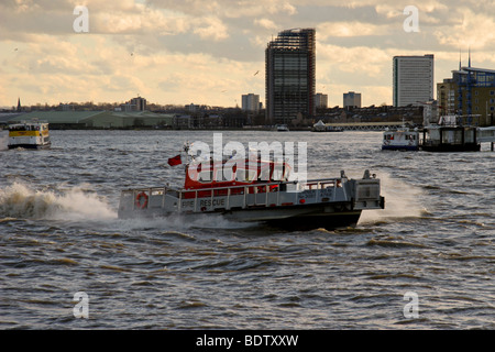 Fire rescue boat rushing to an emergency on the River Thames - Stock Photo