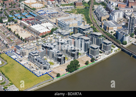 Aerial view of new build project in London on river Thames - Stock Photo