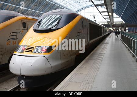 Eurostar trains stand on a platform at St Pancras International Station, London, England - Stock Photo