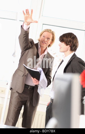 man is teaching something to a trainee - Stock Photo