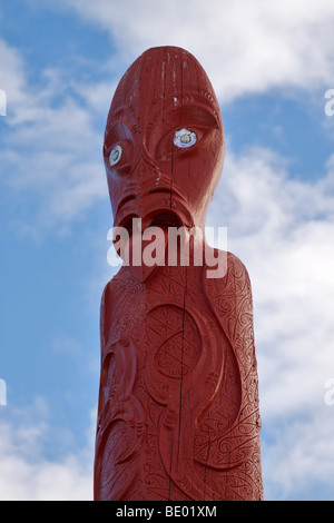 Maori totem pole in a field in the village of Waitangi, Paihia, Bay of Islands, New Zealand - Stock Photo