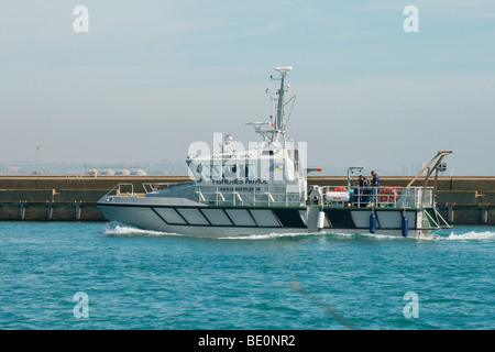 A fisheries patrol vessel returning to Shoreham harbour in Sussex. - Stock Photo
