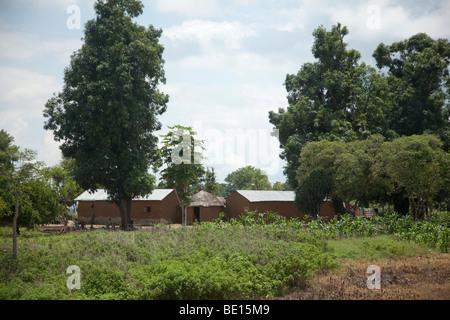 A village near Gurara Falls in Nigeria's Niger State lies peacefully amid the greenery. - Stock Photo