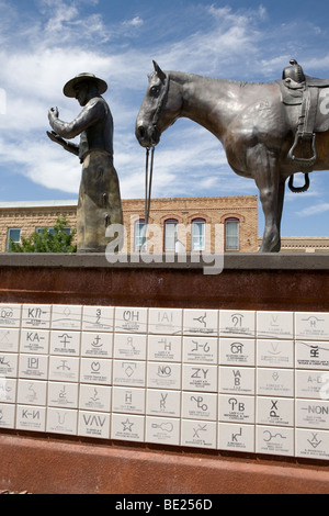 Cowboy and horse bronze downtown Thermopolis, Wyoming - Stock Photo