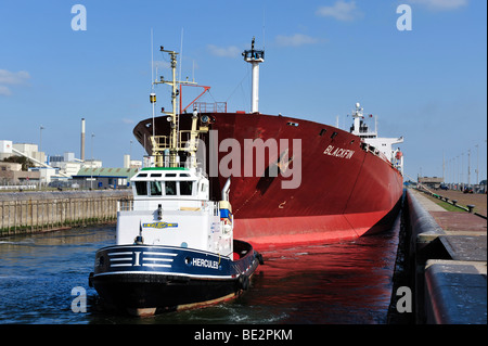 tug boat and oil tanker in the sluice of IJmuiden, The Netherlands, Europe - Stock Photo
