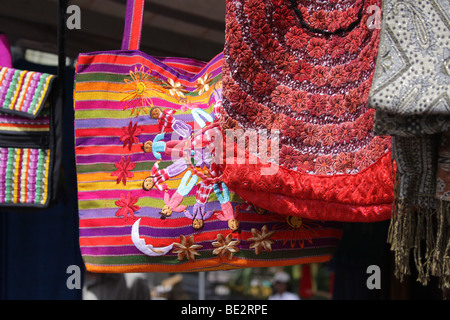 Some hand made bags on display at a street market in Panama City. - Stock Photo
