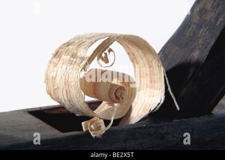 Wood shaving of an antique carpenter's plane - Stock Photo