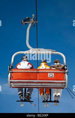 Chairlift, Sella Ronda ski area, Val Gardena, Sella Massif mountain range, Dolomites, South Tirol, Trentino Alto - Stock Photo