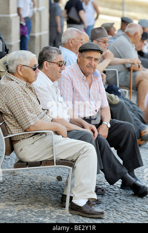 Old men on a bench, Evora, UNESCO World Heritage Site, Alentejo, Portugal, Europe - Stock Photo