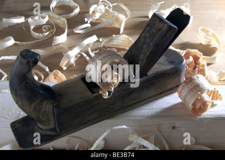 Antique plane with wood shavings - Stock Photo