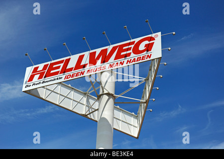 Advertising sign and logo of the Hellweg DIY chain - Stock Photo