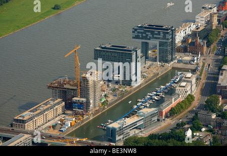 Aerial photograph, Kranhaus crane house construction site in Cologne Rheinauhafen, Pandion AG, Hafenquartier port - Stock Photo