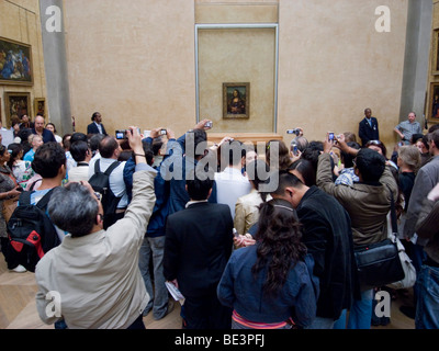 Tourists photographing the 'Mona Lisa' by Da Vinci in the Louvre, Paris, France, Europe - Stock Photo