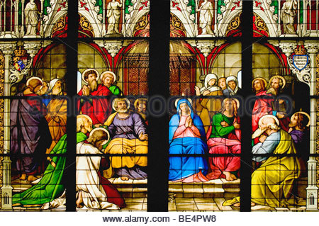 Stained glass in Cologne Cathedral from 1848, central part of the Pentecost window, the Holy Spirit coming to Mary, - Stock Photo