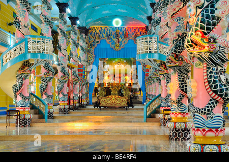 Atrium and altar with the sanctuary in the Cao Dai Temple, Tay Ninh, Vietnam, Asia - Stock Photo