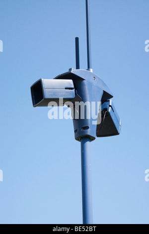 Britain UK. Trafficmaster CCTV cameras against blue sky - Stock Photo