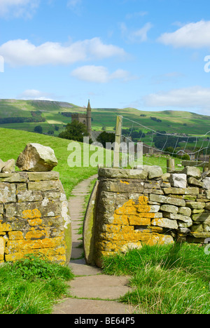 Bealer Bank, a paved path, leading through a stile to Hawes Church, Wenslydale, North Yorkshire, England UK - Stock Photo