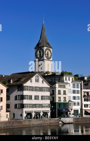 Tower of St. Peter's Church overlooking the rooftops of the historic town centre of Zurich with the Limmat River - Stock Photo